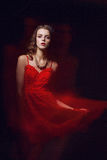 Blurred color art portrait of a girl on a dark background. Fashion woman with beautiful makeup and a light summer dress. Sensual Royalty Free Stock Image