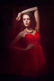 Blurred color art portrait of a girl on a dark background. Fashion woman with beautiful makeup and a light summer dress. Sensual Royalty Free Stock Images