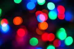 Blurred colored Christmas lights background. Abstract background made of colored blurred Christmas lights Royalty Free Stock Images