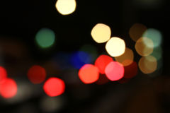 Blurred colored highlights. Background blurred city lights of different colors at night Royalty Free Stock Photos