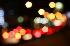 Blurred colored highlights. Background blurred city lights of different colors at night Stock Image
