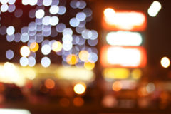 Blurred colored highlights. Background blurred city lights of different colors at night Royalty Free Stock Photo