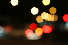 Blurred colored highlights. Background blurred city lights of different colors at night Stock Photo