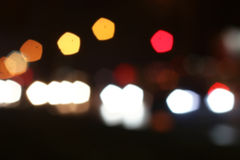 Blurred colored highlights. Background blurred city lights of different colors at night Royalty Free Stock Images