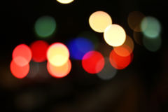 Blurred colored highlights. Background blurred city lights of different colors at night Stock Images