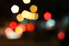 Blurred colored highlights. Background blurred city lights of different colors at night Stock Photos