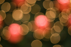 Blurred colored lights. An abstract background of intentionally unfocused colored lights on a dark background Stock Photo
