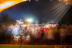 Blurred colored silhouettes of dancing people. Night Stock Photo
