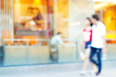 Blurred colorful coffee shop with people walk on street outdoors stock photos