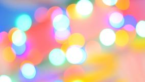 Blurred colorful lights. Red, green, yellow, orange, blue defocused glittering bokeh festive background. stock footage