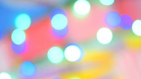 Blurred colorful lights. Red, green, yellow, orange, blue defocused glittering bokeh festive background. Abstract multicolored light. Christmas or party stock footage