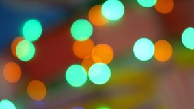 Blurred colorful lights. Red, green, yellow, orange, blue defocused glittering bokeh festive background. Abstract multicolored light. Christmas or party stock video footage