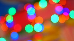 Blurred colorful lights. Red, green, yellow, orange, blue defocused glittering bokeh festive background. Abstract multicolored light. Christmas or party stock video