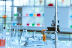 Blurred colorful test tubes at foreground stock photography