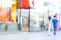 Blurred colorful of walking people in the city with coffee shop royalty free stock photos