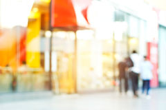 Blurred colorful of walking people in the city with coffee shop royalty free stock photo