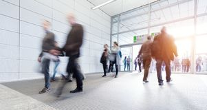 Blurred commuters. At a modern corridor Stock Images
