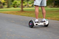 Blurred concept Senior man play riding balance wheels on the road in the park. Blurred concept Senior man play riding balance wheels on the road in the park royalty free stock images