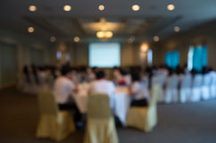 Blurred conference room. Businessman talking in blurred conference room Stock Photos