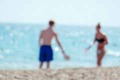 Blurred couple at beach. Stock Image