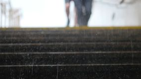 Blurred couple runing down to subway transport from surface in deep rainy day in slow motion. 1920x1080. Couple runing down to subway transport from surface in stock video