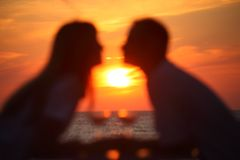 Blurred couple's silhouettes on sunset Stock Photos