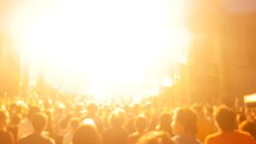 Blurred crowd of people at concert jumping and having fun. While the laser show is hitting the scene stock footage