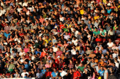 Blurred crowd of people. At a football match in a stadium Stock Images