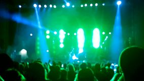 Blurred crowd of people at rock concert. Dancing and having fun stock video