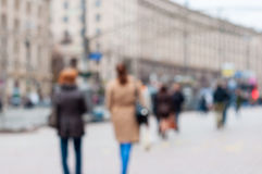 Blurred Crowd of People On Street, unrecognizable. Crowded population as blur urban background Stock Photos