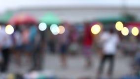 Blurred crowd of people walking. In market stock video