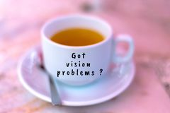 Got vision problems. A blurred cup of a tea with word caption got vision problems Royalty Free Stock Photo