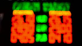 Blurred currency exchange rate on color led display, technology, stock video footage