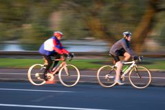 Blurred Cyclists. Cyclists training at dawn stock photos