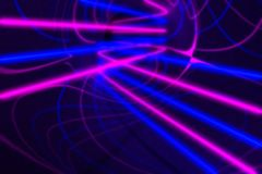 Blurred 3d rendering, glowing lines. Abstract psychedelic background. Ultraviolet lights, purple blue vibrant colors Stock Images