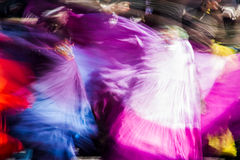 Blurred dancers. Blurred American tribal style dancers royalty free stock photography