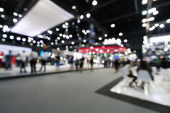 Blurred, defocused background of public event exhibition hall, business trade show concept.