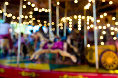 Blurred defocused background of traditional fairground carousel. Blurred defocused background of traditional fairground vintage carousel Stock Photo