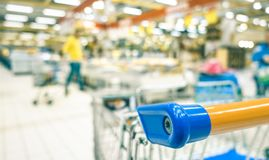 Blurred defocused bokeh of grocery supermarket - Consumerism concept. In economic crisis moment at commercial center - Shallow depth of field with focus on Stock Image