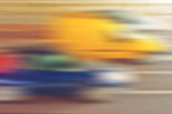 Blurred defocused cars in motion as abstract urban background stock photo