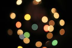 Blurred defocused christmas light lights bokeh background. Colorful red yellow blue green de focused glittering pattern. Concept. Xmas colors stock images