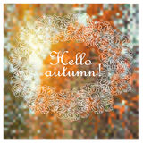 Blurred defocused landscape background with leaves with text Hello autumn. Royalty Free Stock Image