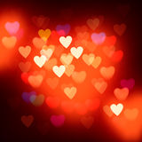 Blurred defocused lights background with hearts Royalty Free Stock Photos
