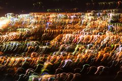 Blurred defocused lights of the evening city. Blurred lights for abstract background royalty free stock photos