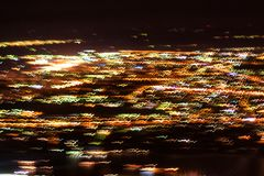 Blurred defocused lights of the evening city. Blurred lights for abstract background stock image