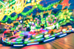 Blurred defocused lights at luna park carousel roundabout Stock Photos