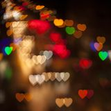 Blurred Defocused Multi Color Lights in the Shape of Heart. Night City Royalty Free Stock Photography
