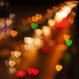 Blurred Defocused Multi Color Lights in the Shape of Heart. Night City Royalty Free Stock Image