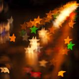 Blurred Defocused Multi Color Lights. In the Shape of Stars Royalty Free Stock Image