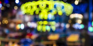 Blurred multicolored lights of the carousel in the night park look like a skeleton skull suitable for the Day of the Dead Dia de. Blurred and defocused royalty free stock photography